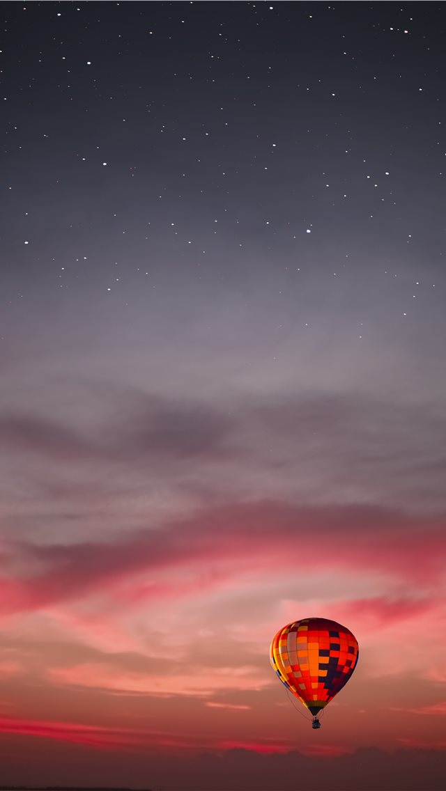 flying multicolored hot air balloon iPhone wallpaper