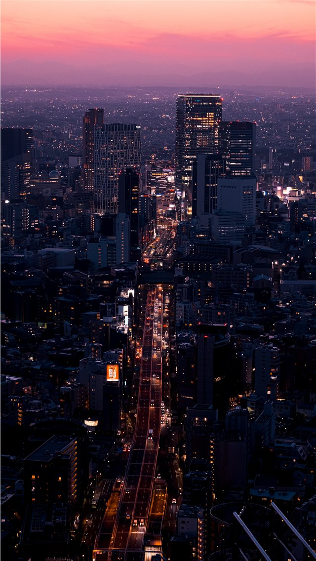aerial view of city buildings during night time iPhone wallpaper