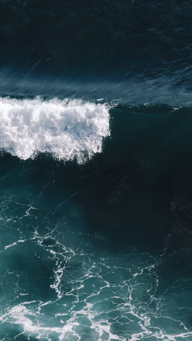 aerial view of ocean waves iPhone wallpaper