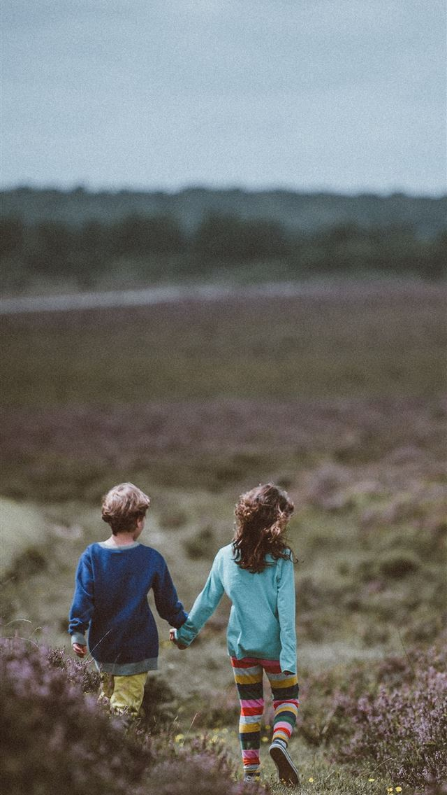 siblings walking holding hands and background iPhone wallpaper