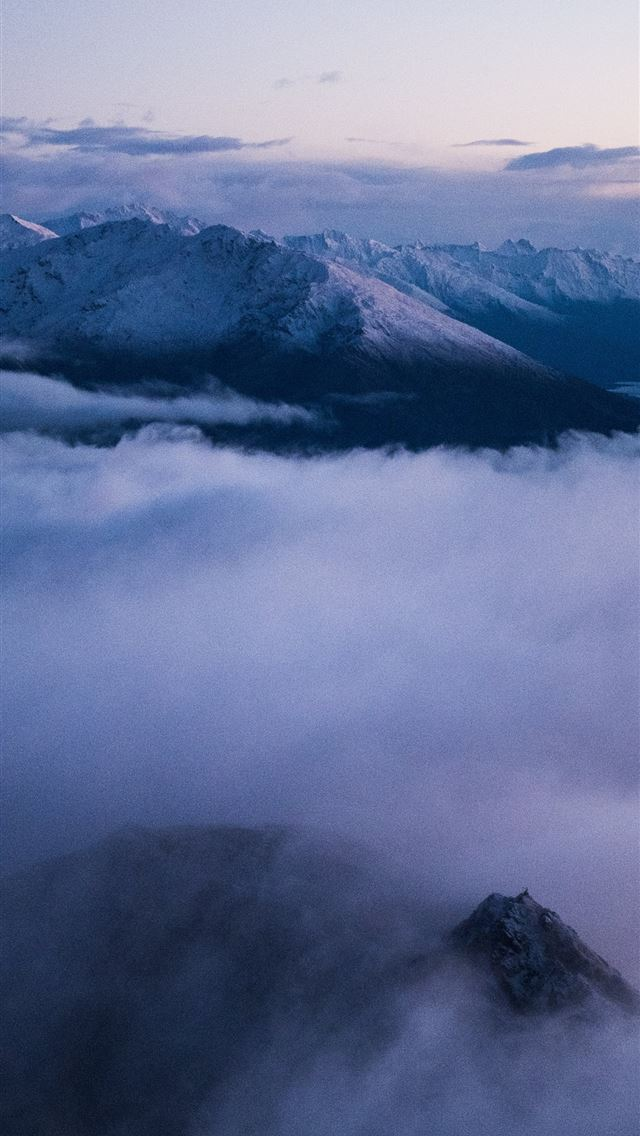 aerial photo of sea of clouds and mountain iPhone wallpaper