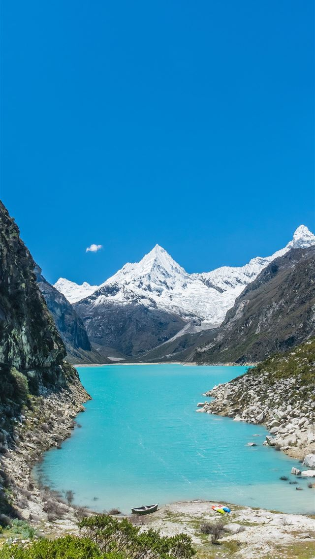 body of water surrounded by mountains iPhone wallpaper