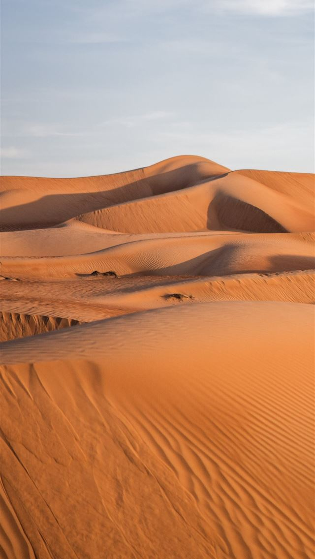brown sand under blue sky during daytime iPhone wallpaper