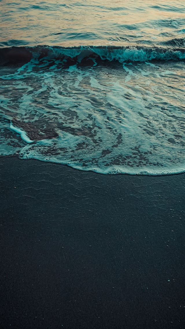 ocean waves crashing on shore during daytime iPhone wallpaper