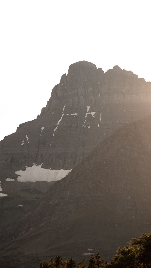 photography of mountain range during daytime iPhone wallpaper