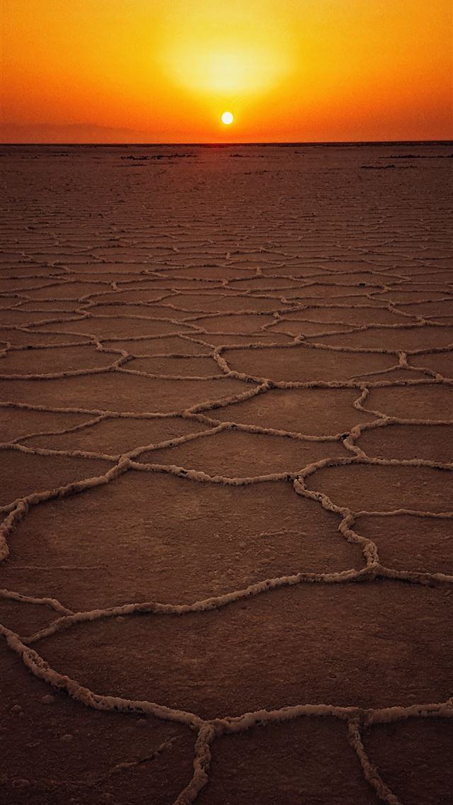 dried land at golden hour iPhone wallpaper