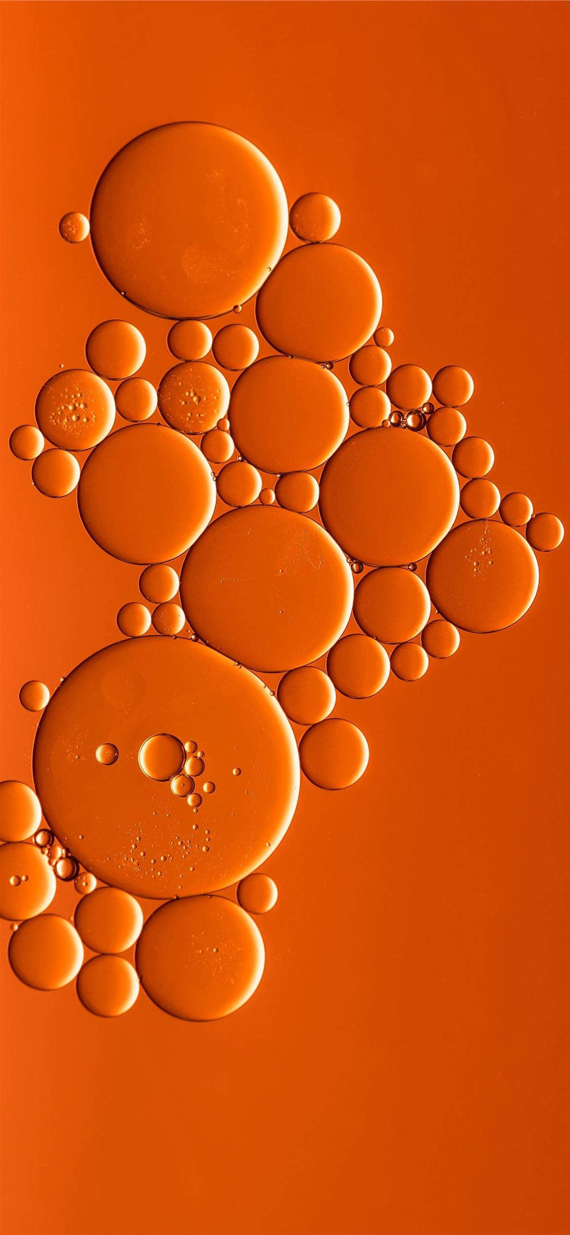 orange bubbles art iPhone X wallpaper
