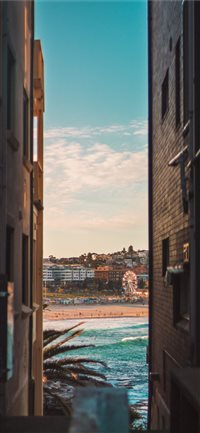 Bondi beach between two houses iPhone X(S/Max/R) wallpaper