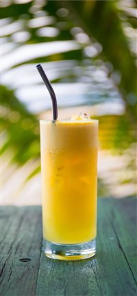 Fresh Pineapple Juice with Stainless Steel Straw iPhone X wallpaper