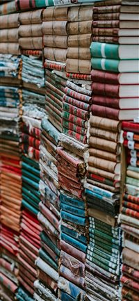 Piles of old worn books iPhone X wallpaper