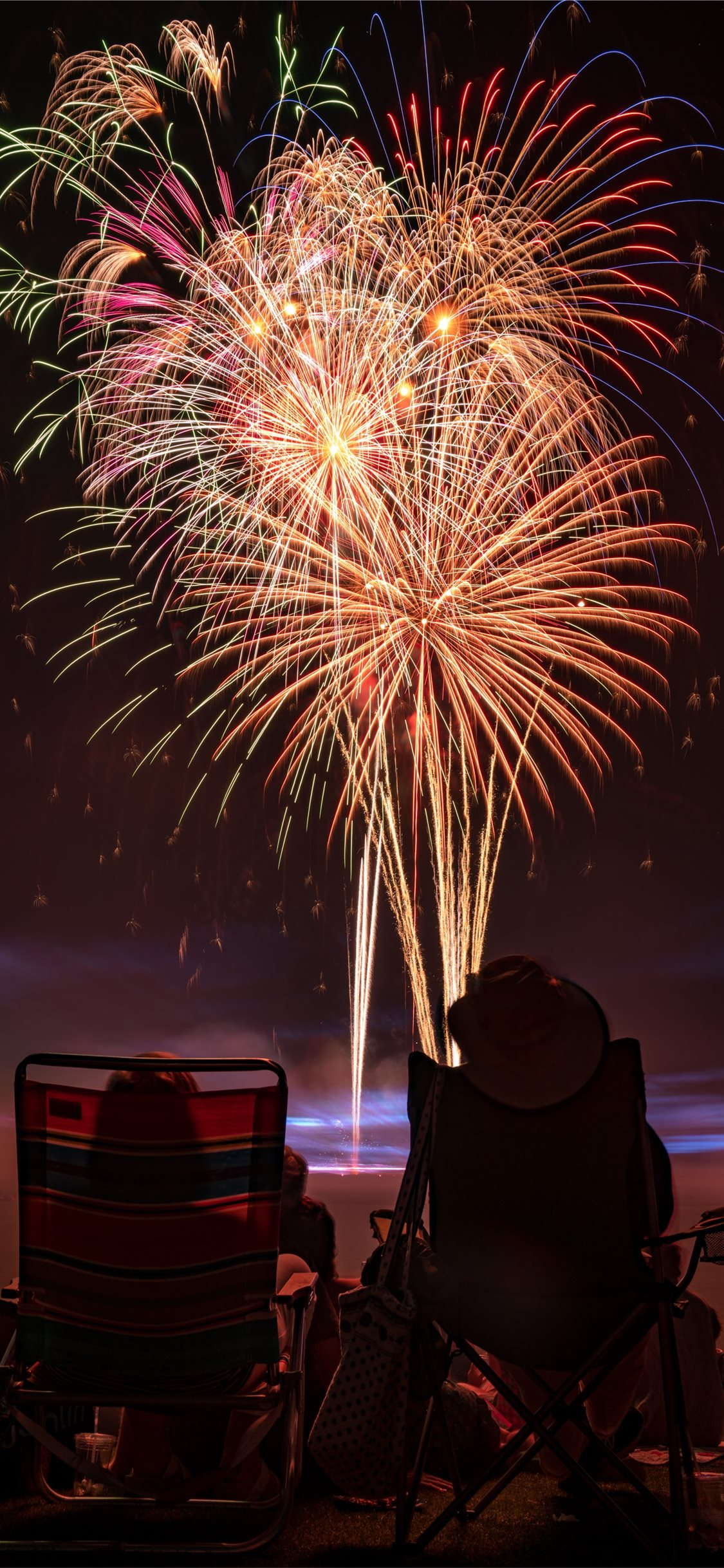 two people watching fireworks display iPhone X Wallpapers