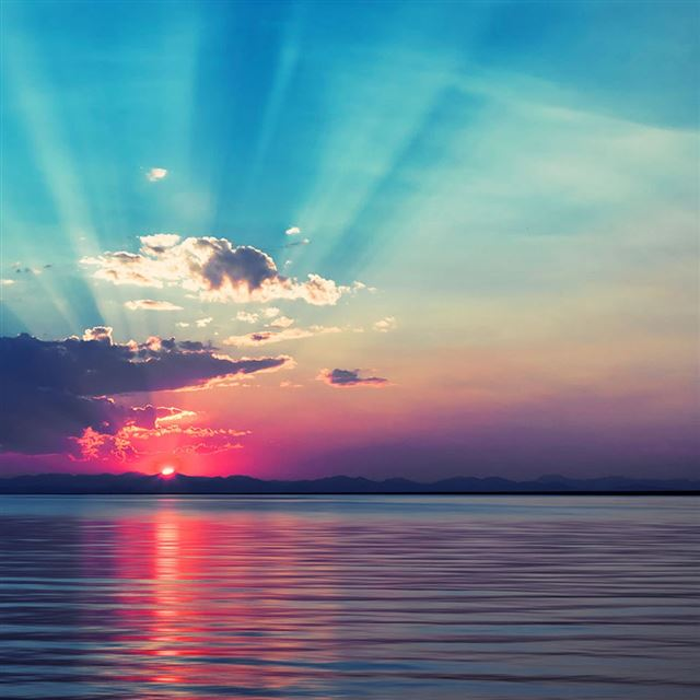 Sunrise at sea iPad wallpaper