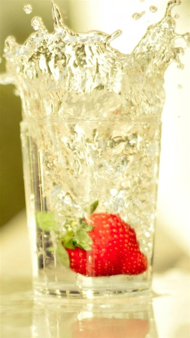 Strawberry Falling In Glass Of Water iPhone 8 wallpaper