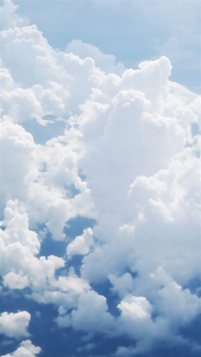Puffy White Clouds iPhone 8 wallpaper