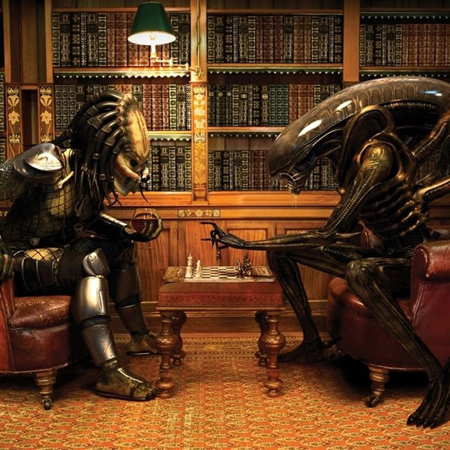 Alien and Predator Playing Chess iPad wallpaper