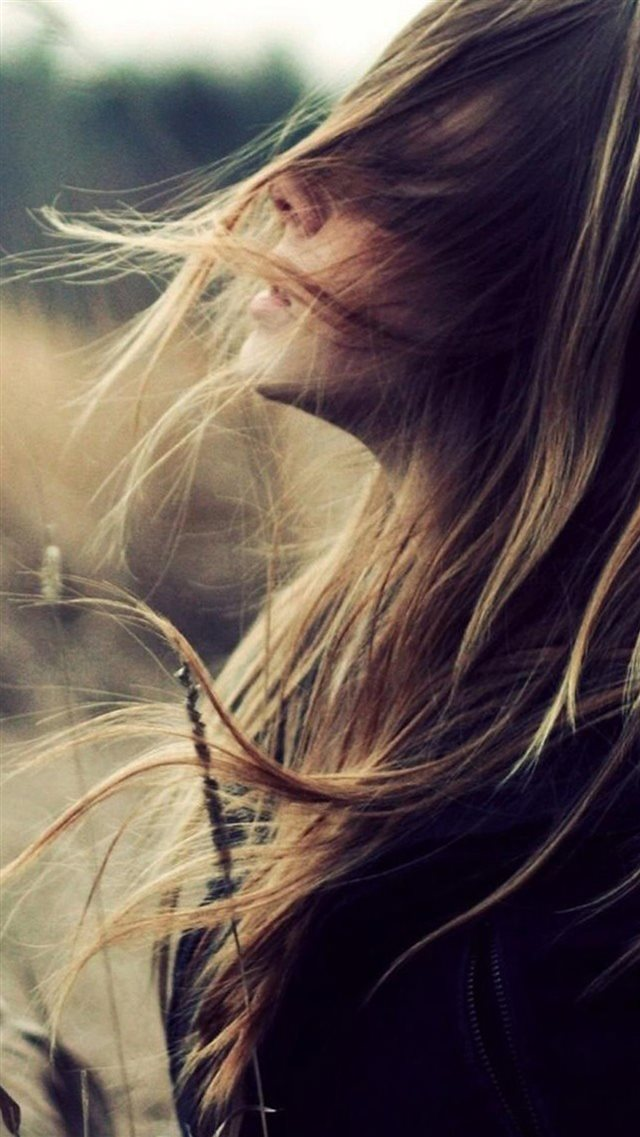 Beautiful Girl Face Flying Hair iPhone 8 wallpaper