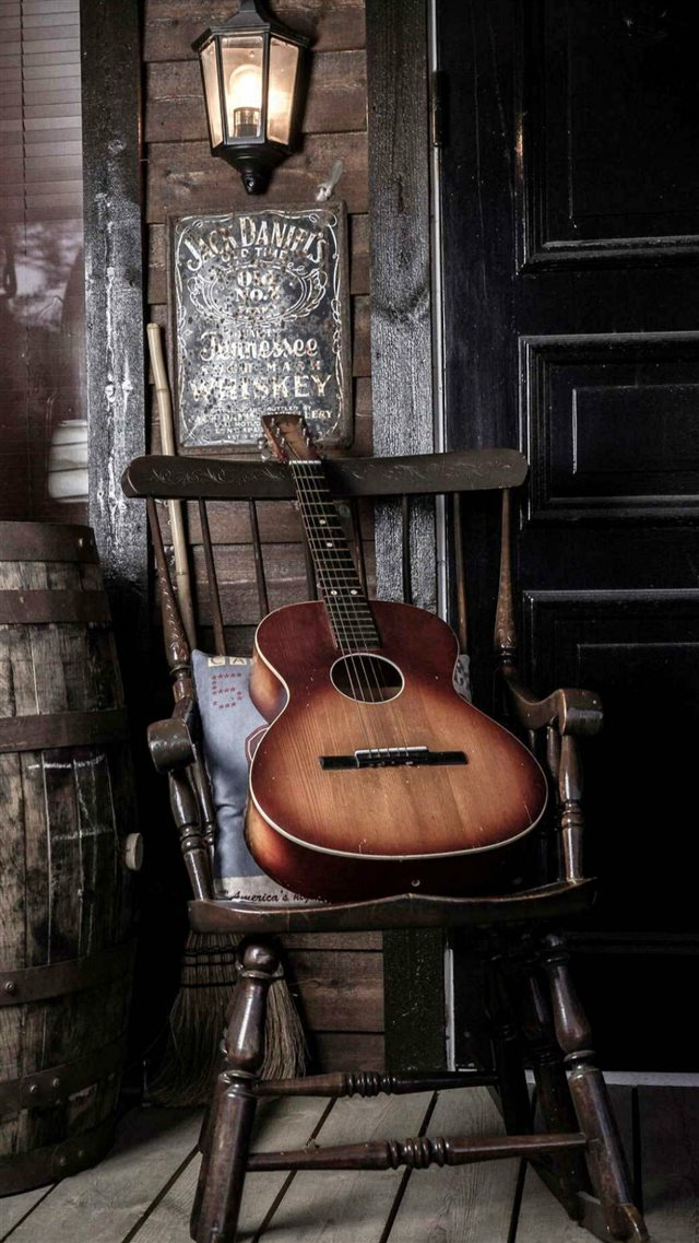 Old Guitar On Chair  iPhone 8 wallpaper