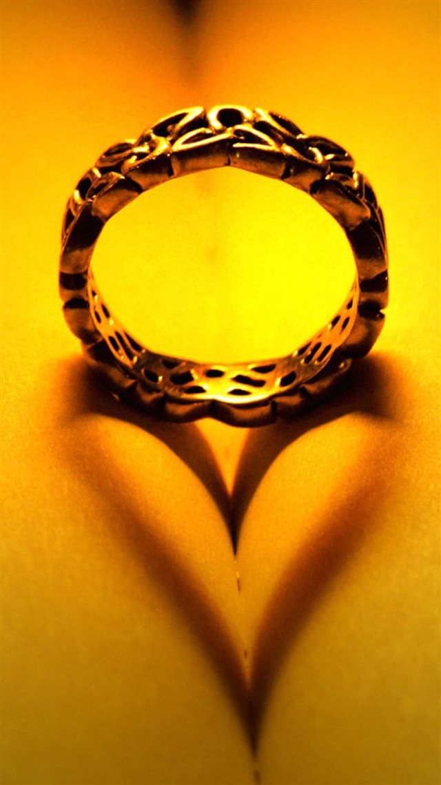 Golden Ring Book Love Shaped Shadow iPhone 8 wallpaper