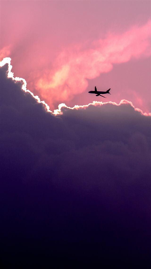 Plane Above Sunset Clouds iPhone 8 wallpaper