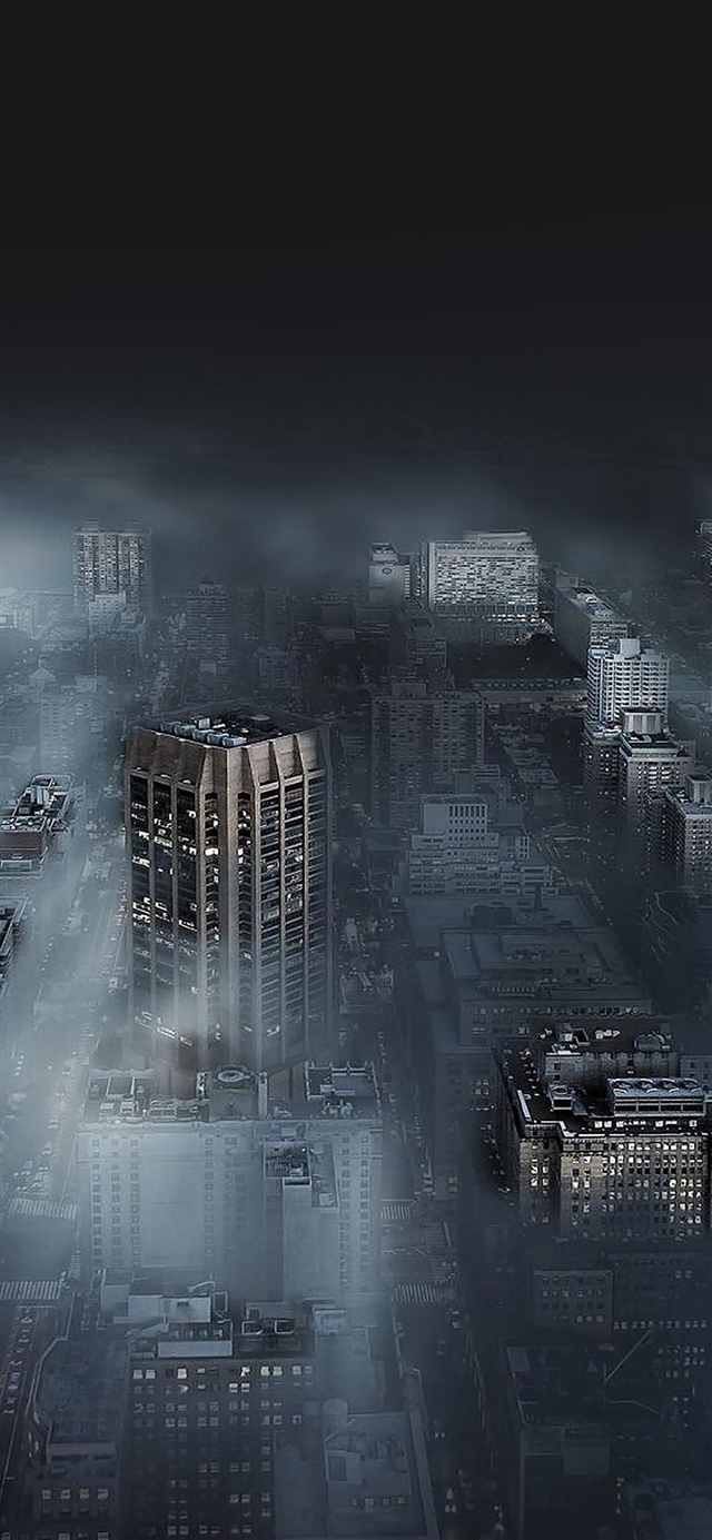 Dark city in fog iPhone X wallpaper