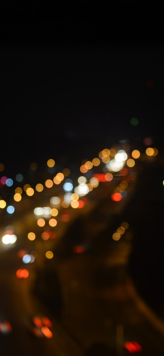 Night bokeh light street iPhone X wallpaper