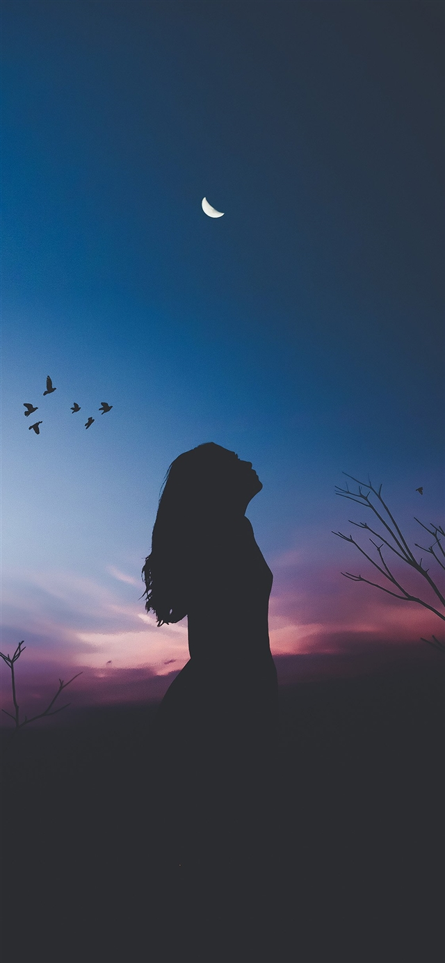 The girl was silhouetted at night iPhone X wallpaper