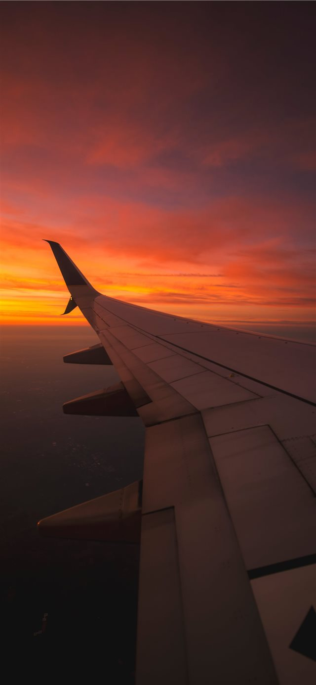 Sunset View From the Window of an Airplane iPhone 11 wallpaper