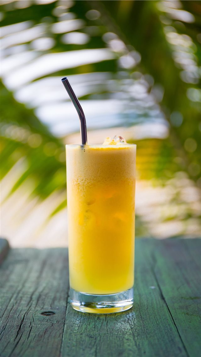 Fresh Pineapple Juice with Stainless Steel Straw iPhone SE wallpaper