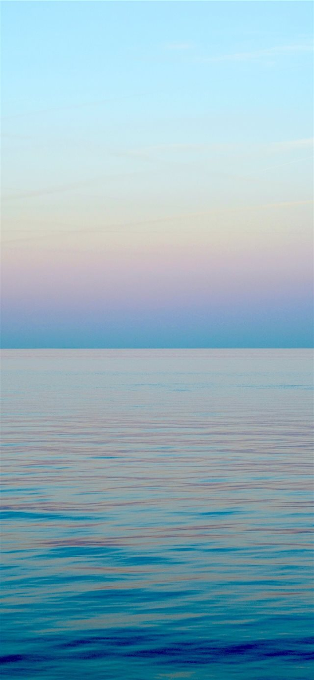 Twilight hour from Copenhagen's Strandvejen iPhone X wallpaper