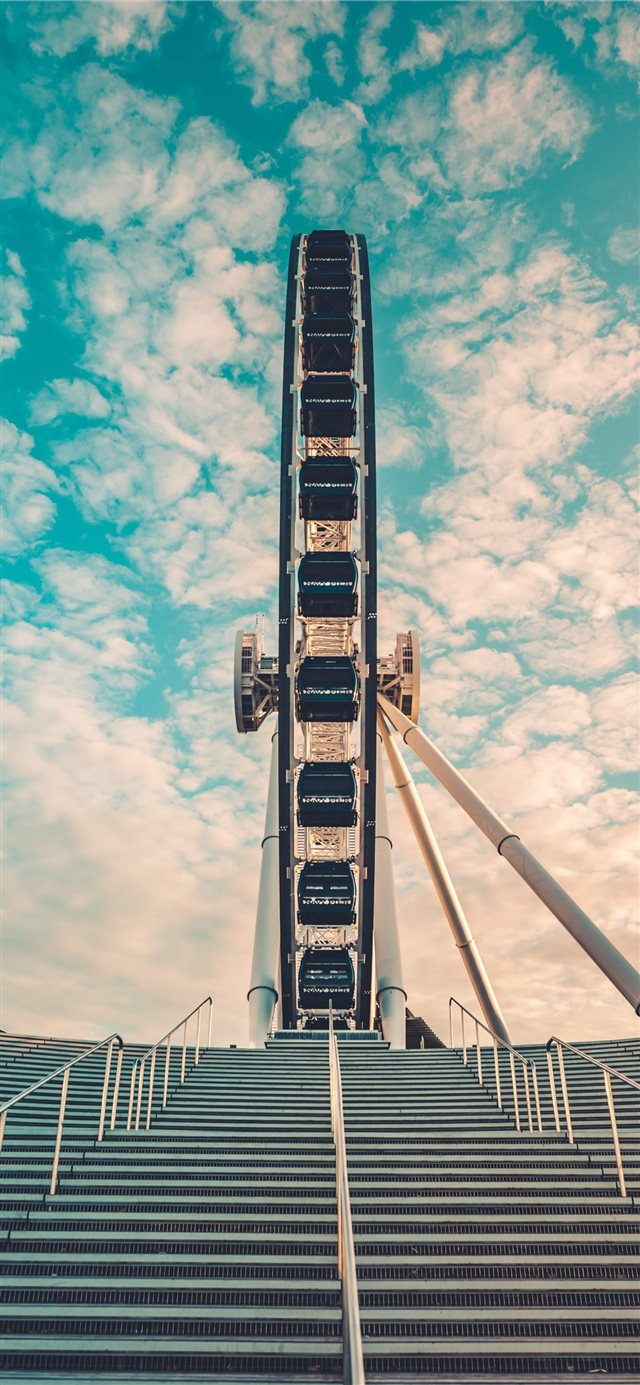 I took this shot walking past the Ferris Wheel fro... iPhone X wallpaper