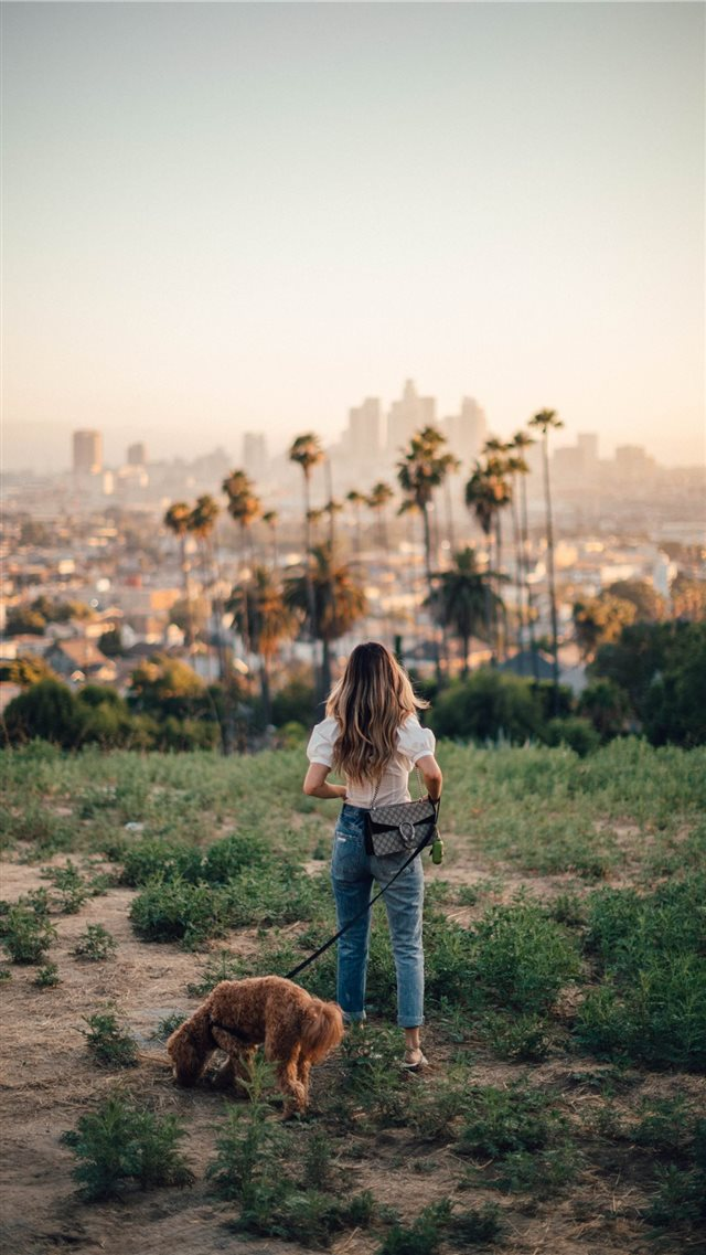 Carleigh  Odie and I out for a walk in East Los An... iPhone SE wallpaper