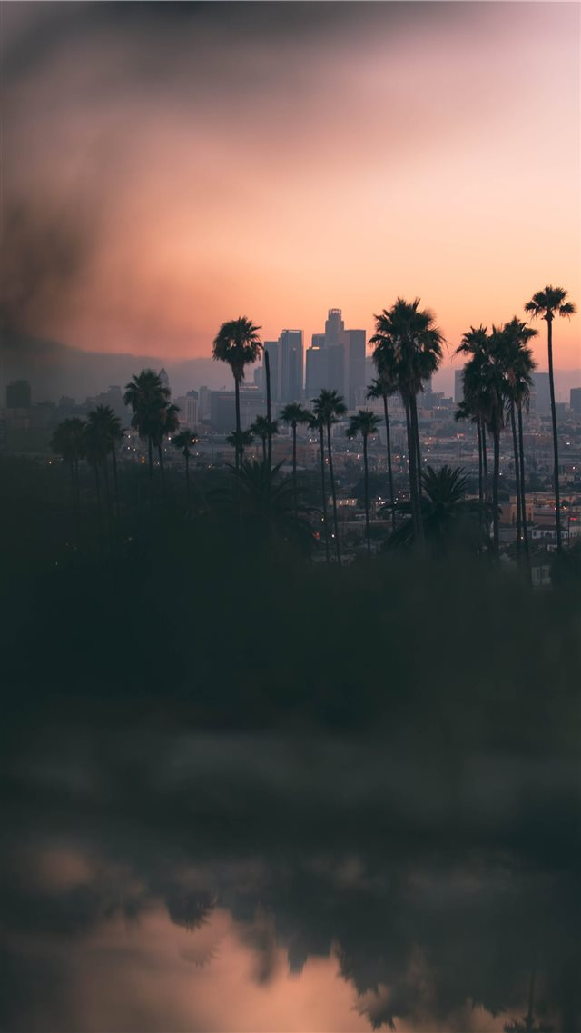 Hazy sunset in East Los Angeles  from Montecito He... iPhone 8 wallpaper