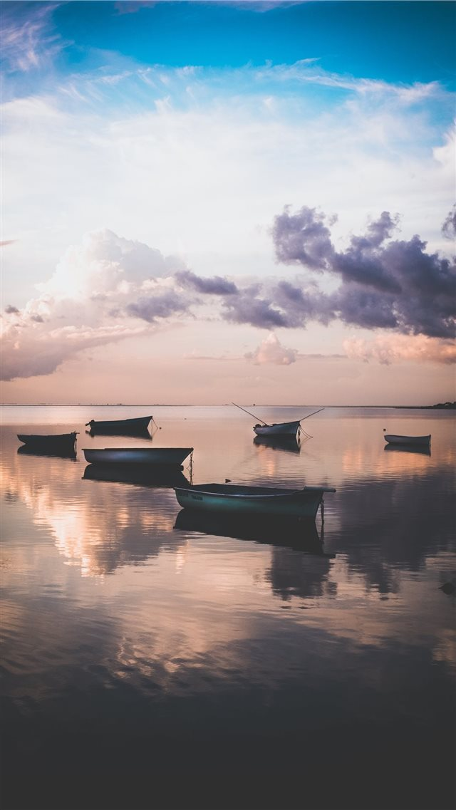 Sunset in Mauritius whilst the tide rolls in  iPhone 8 wallpaper