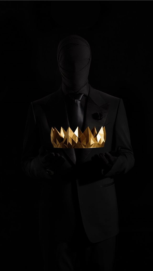 Silhouette holding gold crown iPhone 8 wallpaper