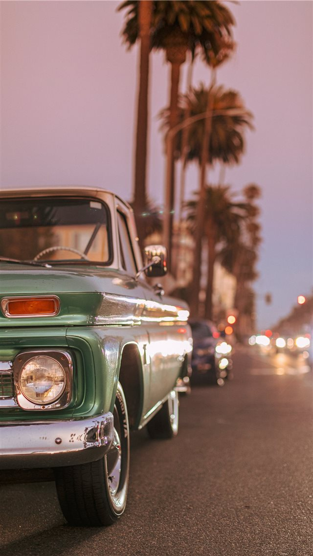 Vintage car parked on Ocean Blvd during sunset  iPhone 8 wallpaper