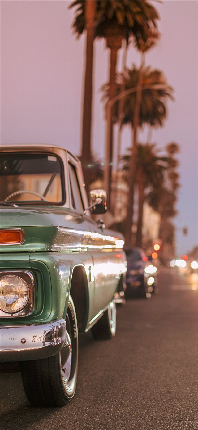 Vintage car parked on Ocean Blvd during sunset  iPhone X wallpaper