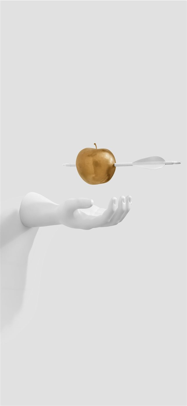 White hand paused for golden apple iPhone X wallpaper