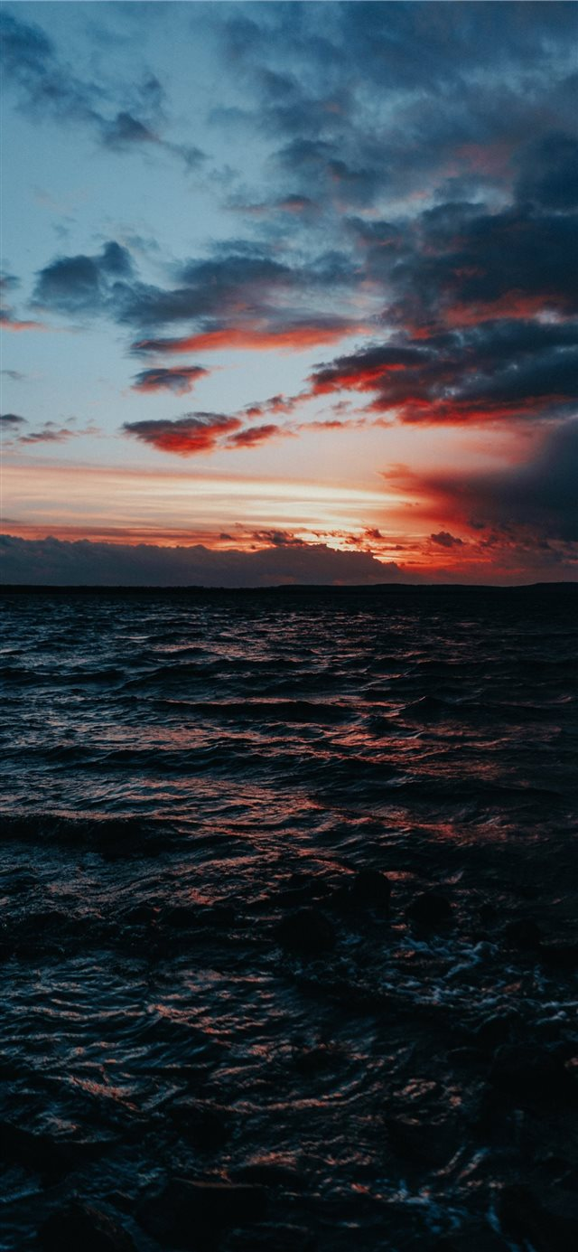 body of water under grey sky iPhone 11 wallpaper