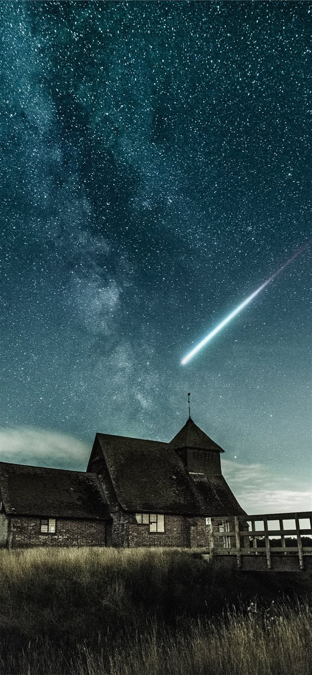 brown house under stary night iPhone 11 wallpaper