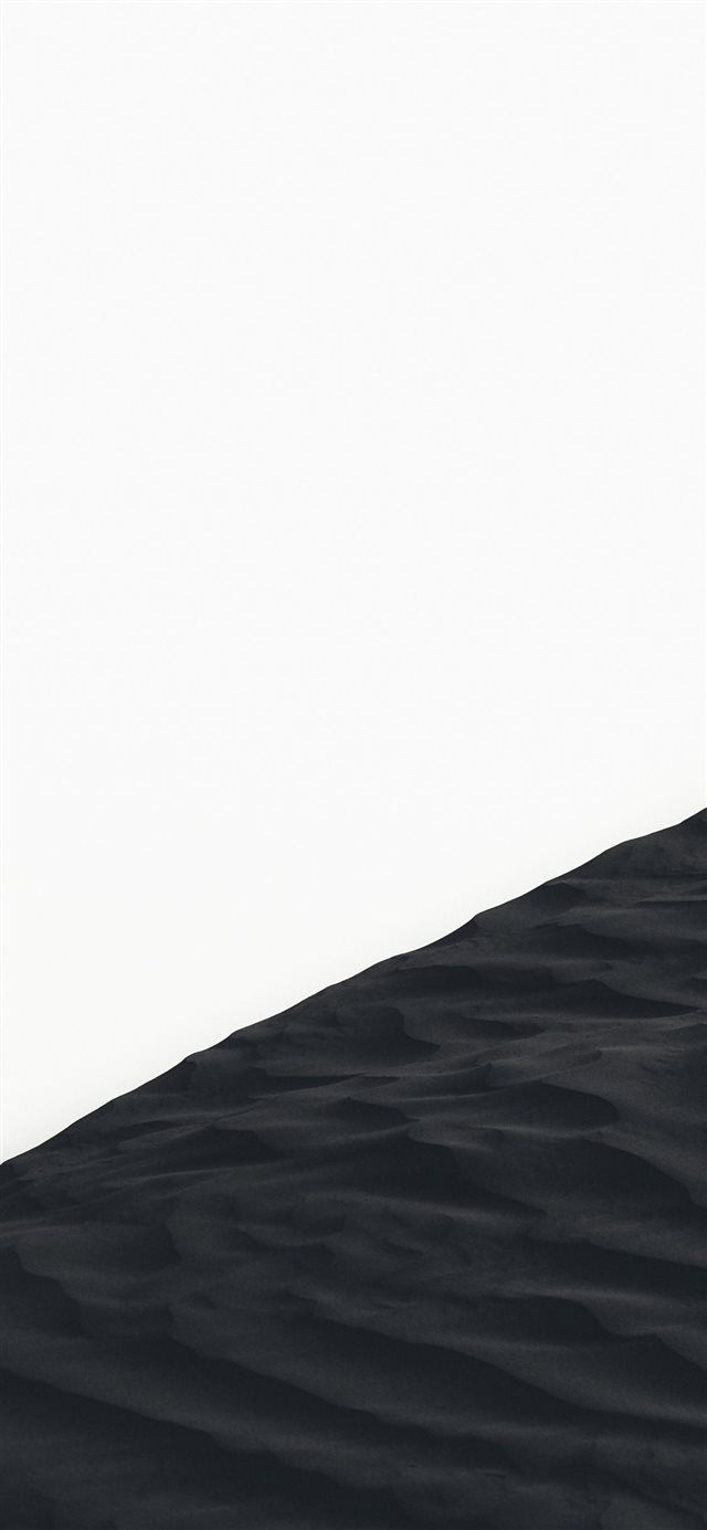 grayscale photo of sand dunes iPhone X wallpaper