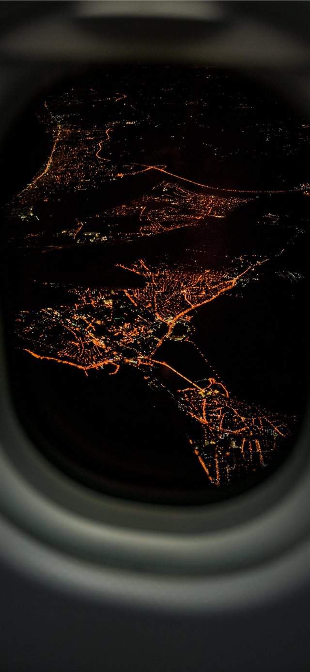 lighted city airplane view iPhone 11 wallpaper