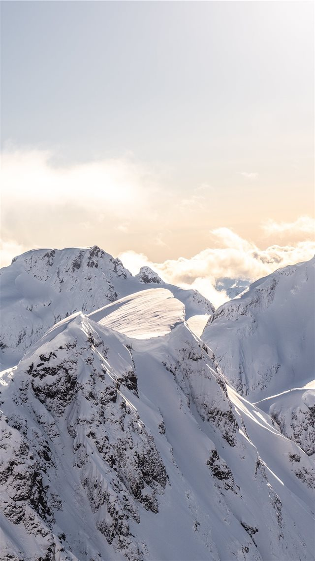 mountains covered by snow at daytime iPhone SE wallpaper