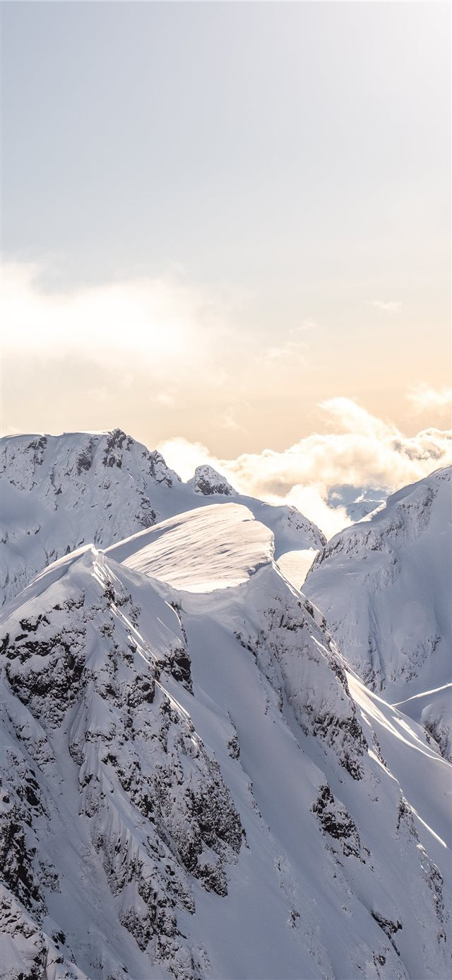 mountains covered by snow at daytime iPhone 11 wallpaper