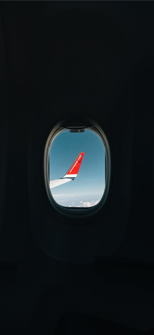 red airplane wing through window iPhone X wallpaper