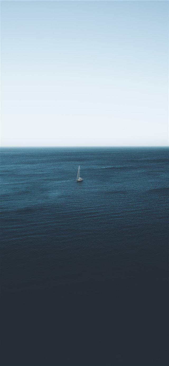 sailboat on body of water during daytime iPhone X wallpaper