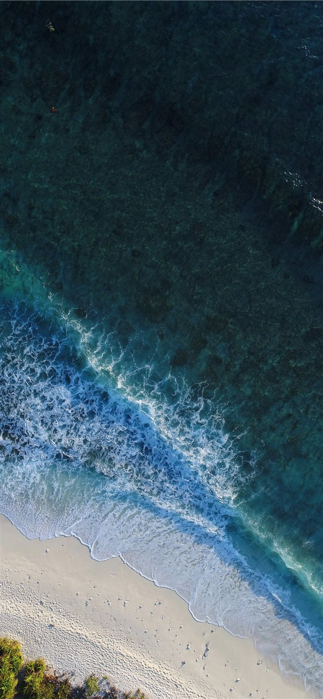 turquoise calm sea wave splashing on white sand be... iPhone X wallpaper