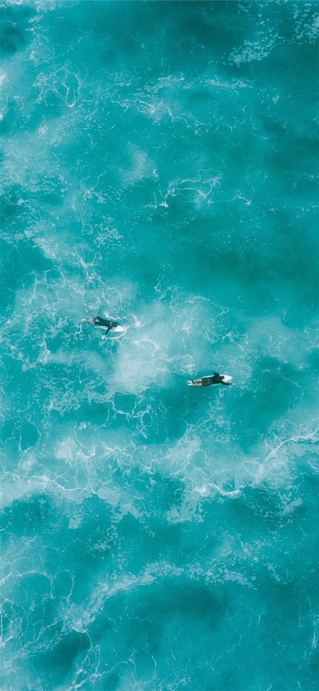 two people surfing on water iPhone 11 wallpaper
