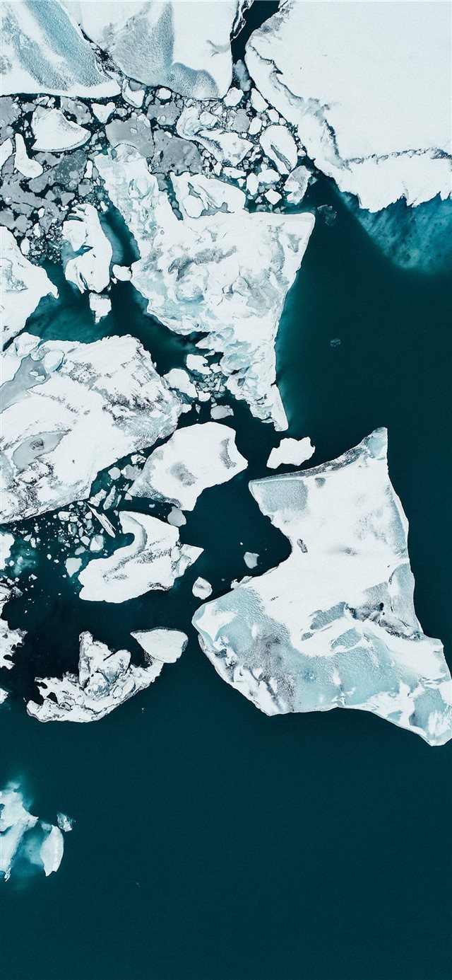 white ice on body of water during daytime iPhone 11 wallpaper
