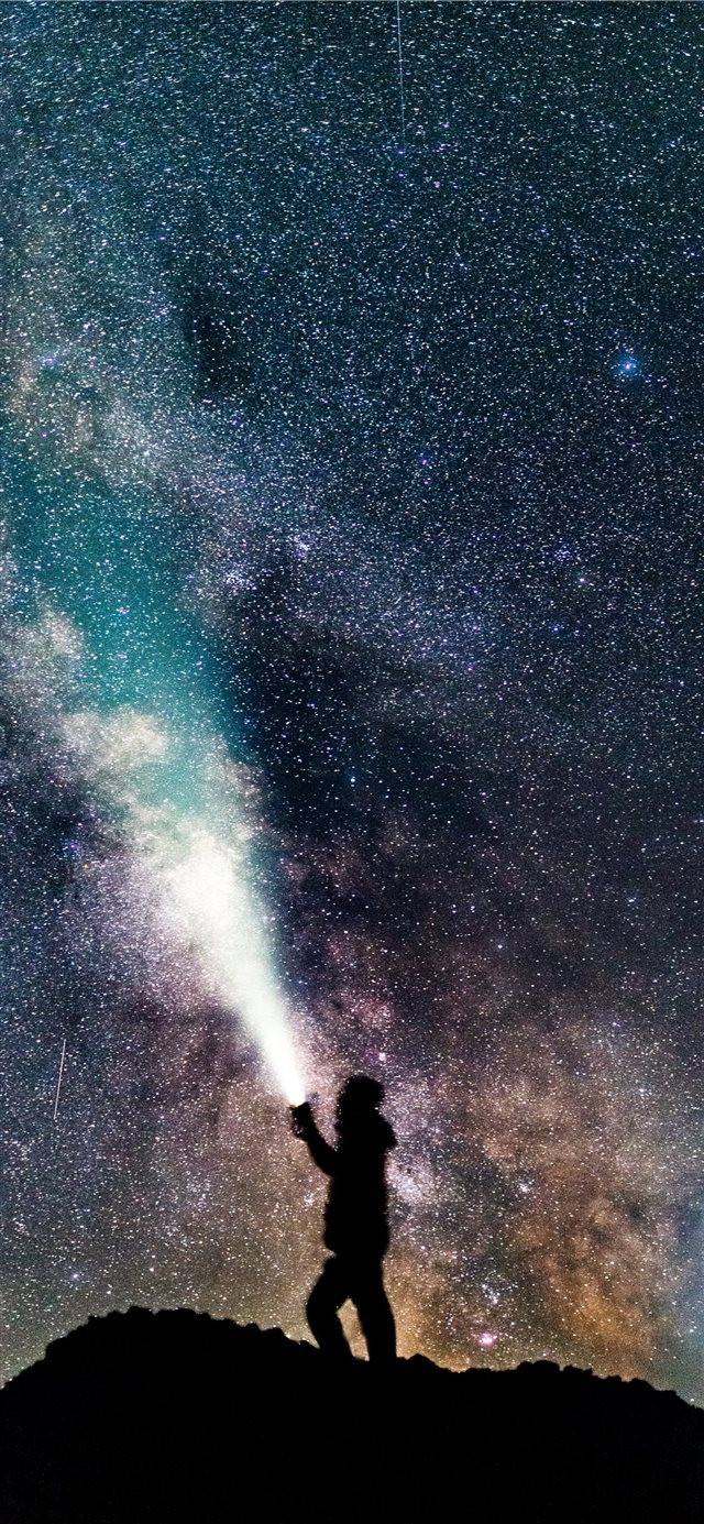 a sefie underneath the milky way iPhone 11 wallpaper
