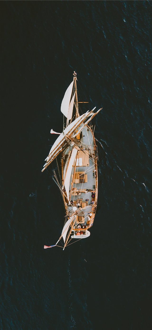 aerial photography of brown galleon ship on body o... iPhone 11 wallpaper
